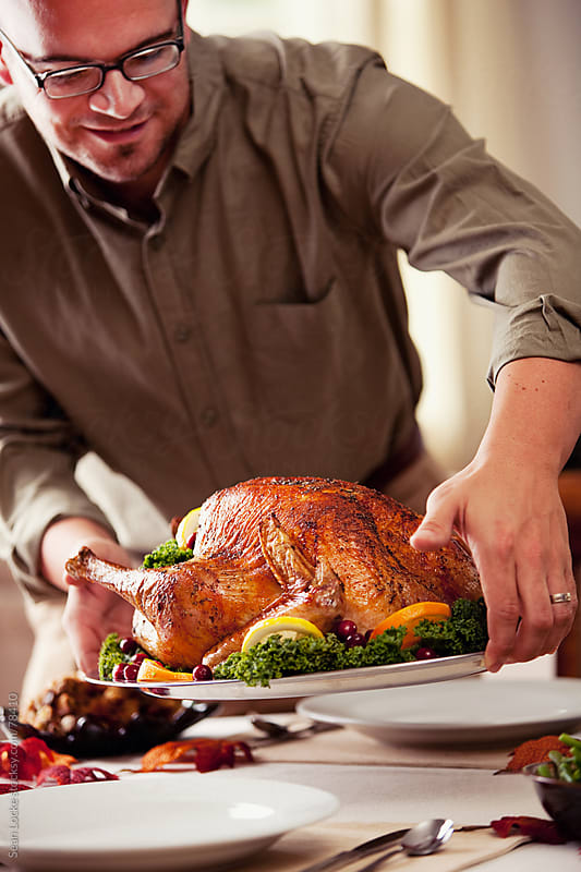 Thanksgiving: Putting the Turkey on the Table by Sean Locke for Stocksy United