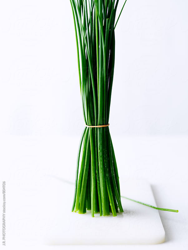 Fresh chives, tied in a bunch by J.R. PHOTOGRAPHY for Stocksy United