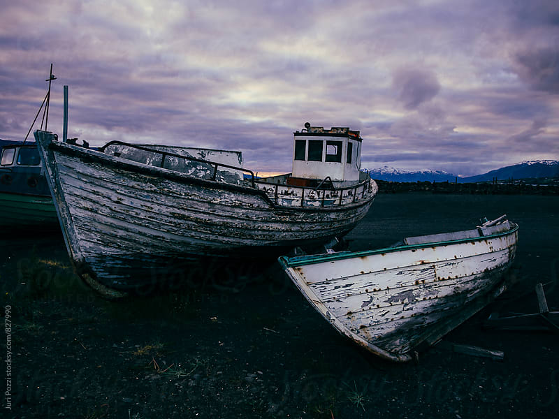 Boats ground in a port in Iceland by Juri Pozzi for Stocksy United