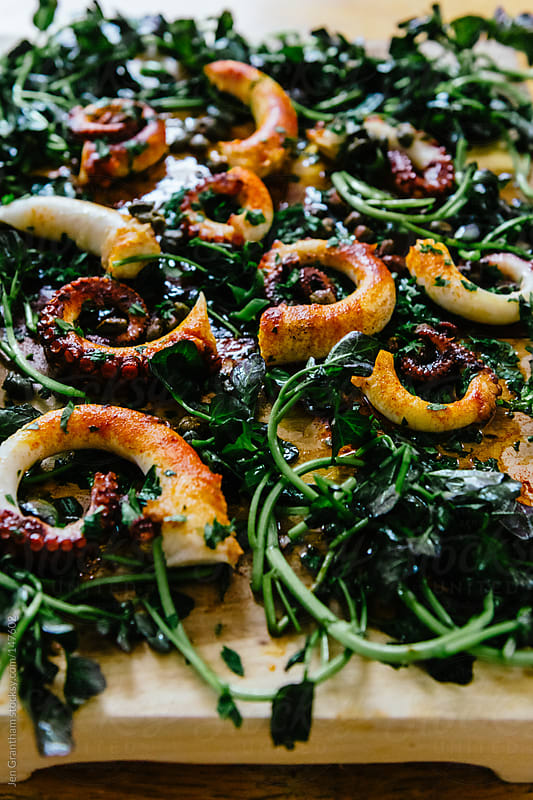 Octopus with Capers by Jen Grantham for Stocksy United