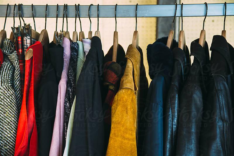 Old Coats on Wooden Hangers by Gabriel (Gabi) Bucataru for Stocksy United