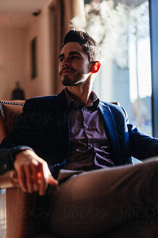 Young Businessman Waiting in a Longe Room by HEX. for Stocksy United