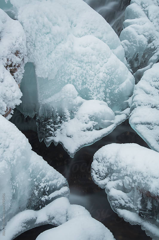 Abstract ice formation on a waterfall in winter by Riley J.B. for Stocksy United