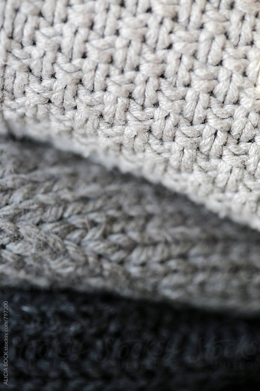 A Close Up Of A Stack Of Gray Winter Sweaters by ALICIA BOCK for Stocksy United