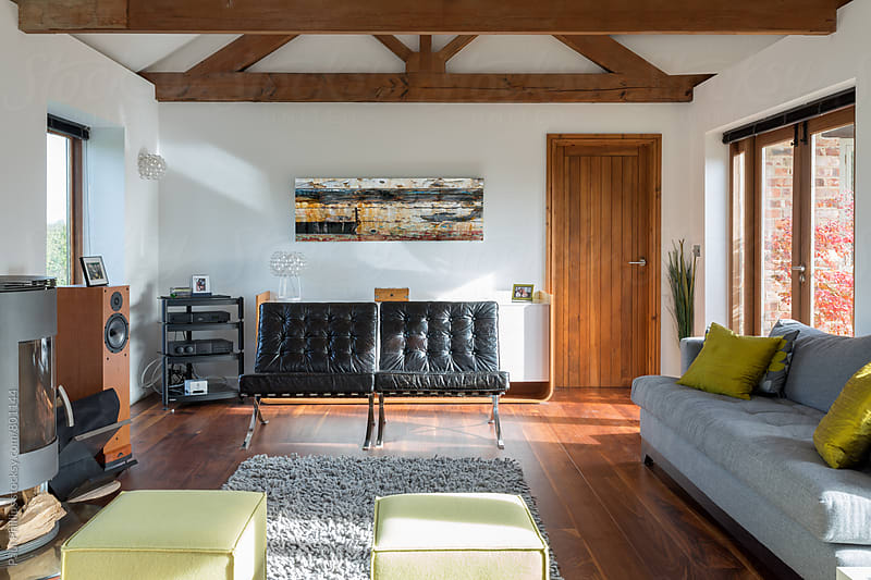 Modern living room part of a converted barn. by Paul Phillips for Stocksy United