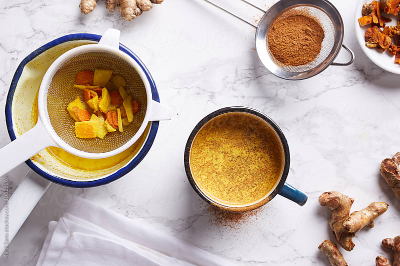 Turmeric tea powdered with cinnamon by Martí Sans for Stocksy United