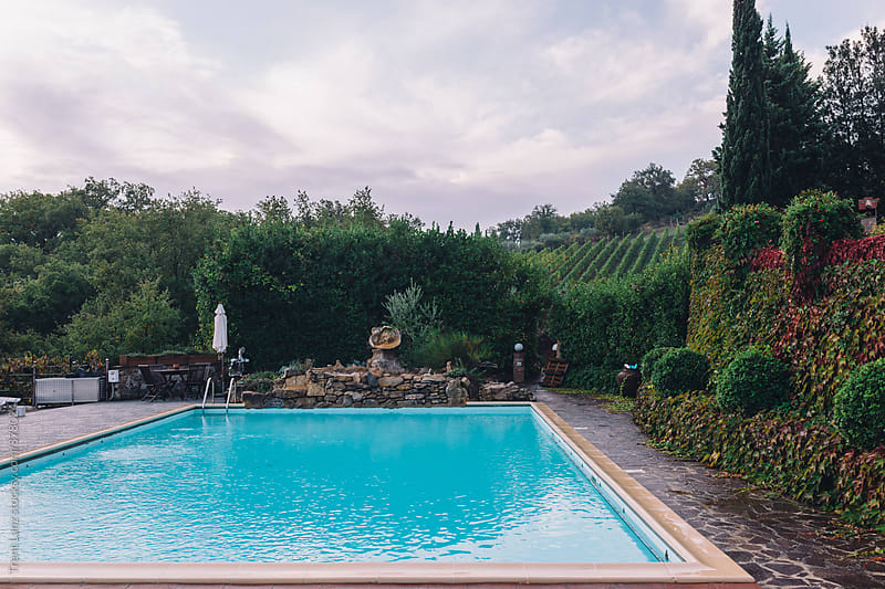 View on swimming pool in Italian home by Trent Lanz for Stocksy United