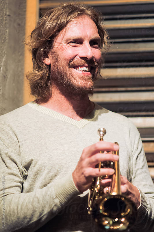 Happy musician with his trumpet by Per Swantesson for Stocksy United