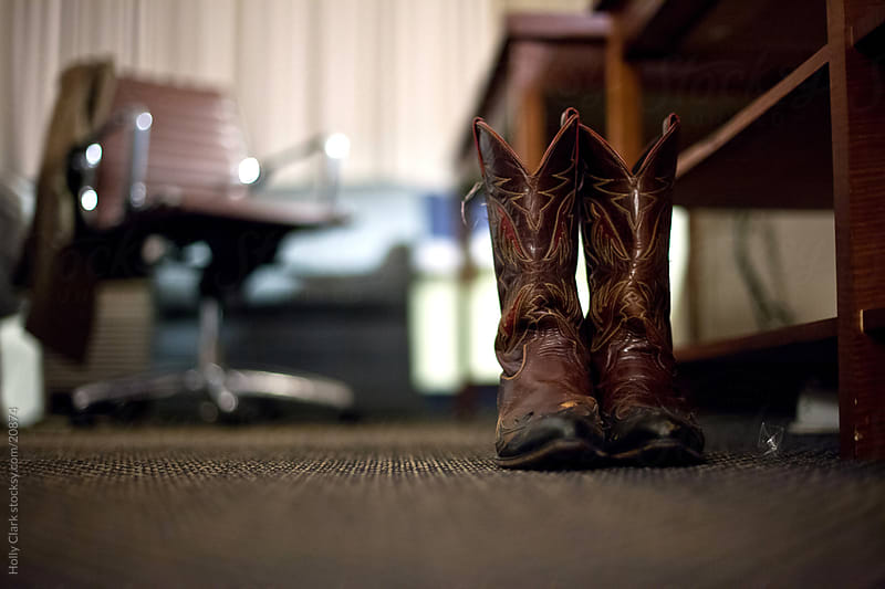 Cowboy Boots Sitting on the Floor at Night by Holly Clark for Stocksy United
