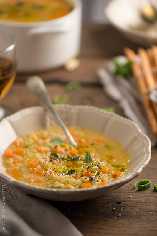 vegan soup with millet and almond by Laura Adani for Stocksy United