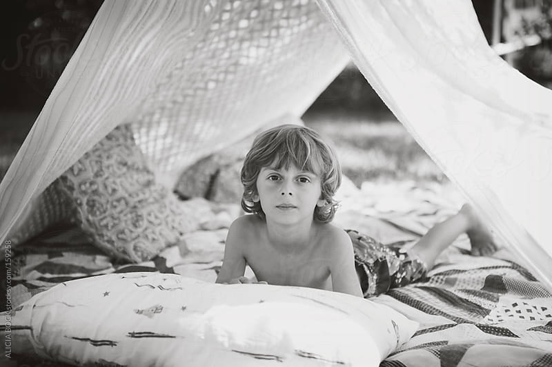Boy In A Play Tent by ALICIA BOCK for Stocksy United