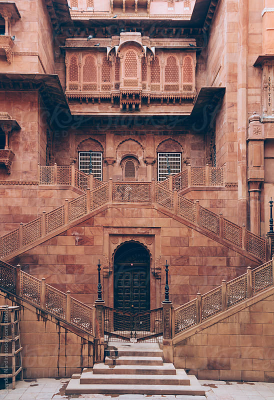 symmetric staircase in an ancient indian fort by Leander Nardin for Stocksy United