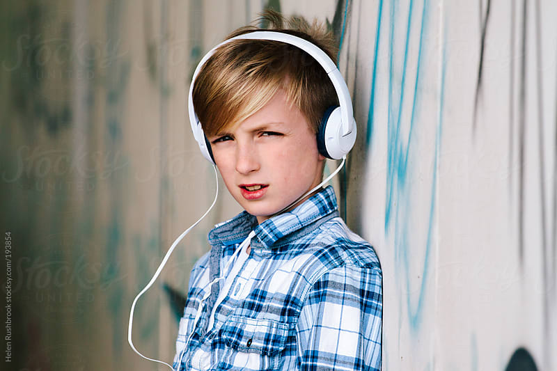 Trendy young boy wearing headphones. by Helen Rushbrook for Stocksy United