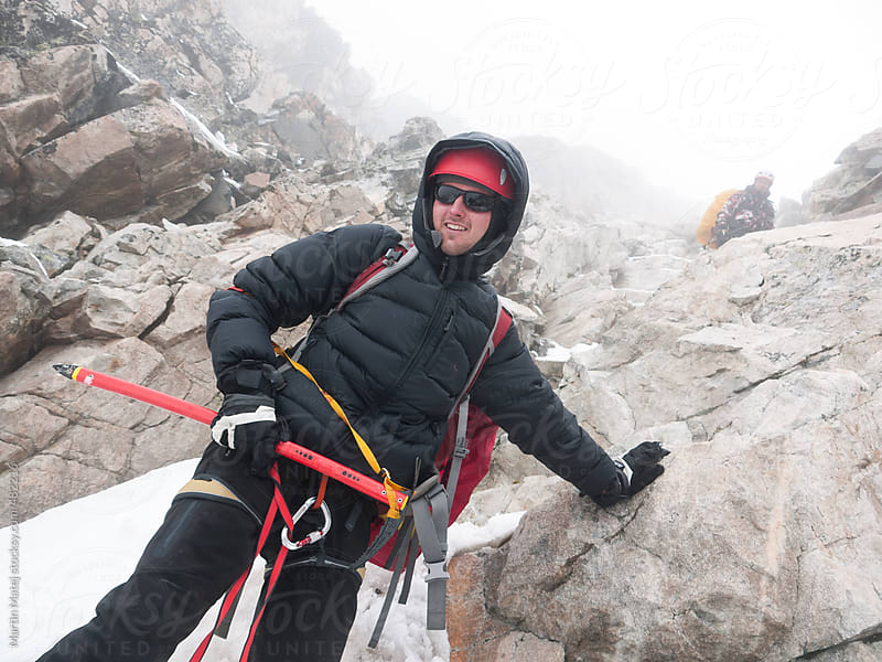 Young alpine climber descending from mountain by Martin Matej for Stocksy United