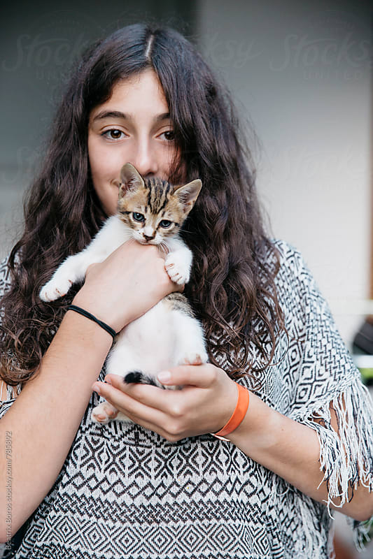 Girl found her favorite kitty, showing it to the camera by Beatrix Boros for Stocksy United