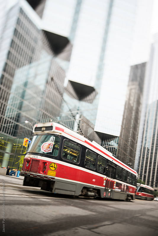 the  tram moving on the street in Toronto by Javier Pardina for Stocksy United