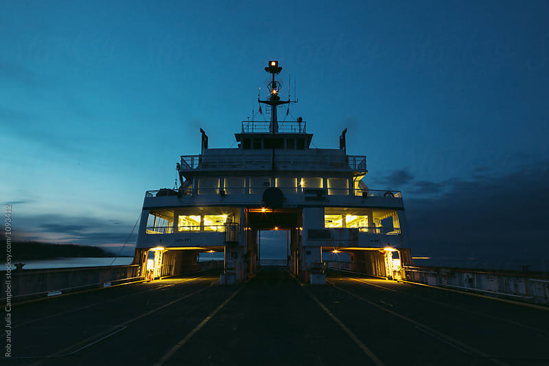 Empty ferry boat at dusk by Rob and Julia Campbell for Stocksy United