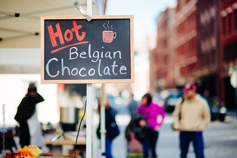 Sign for hot chocolate at an outdoor market in the city by Lauren Naefe for Stocksy United