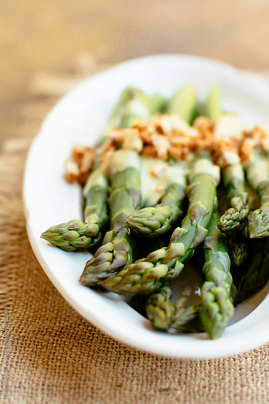 Asparagus with Lemony Mustard Sauce and Spicy Tofu Pieces by Harald Walker for Stocksy United
