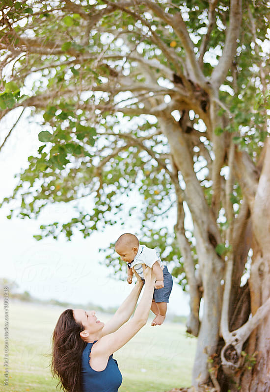 Mother with interracial baby son by Marlon Richardson for Stocksy United