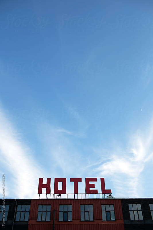 Hotel sign by Tommaso Tuzj for Stocksy United