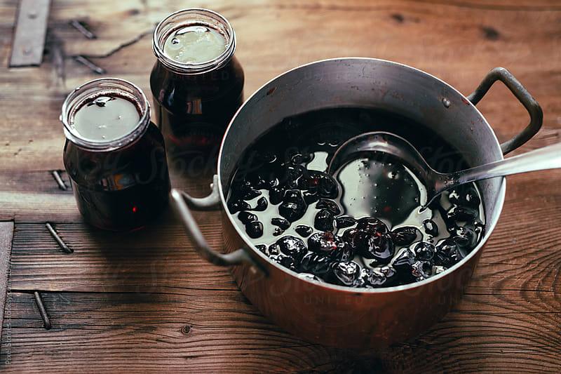 Making homemade cherry jam by Pixel Stories for Stocksy United