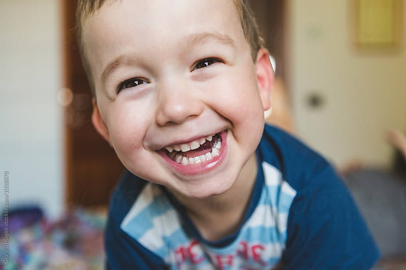 Happy Toddler at Home Smiling at Camera by Giorgio Magini for Stocksy United