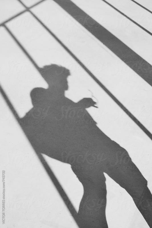 Shadow of a Backpacker in the Floor by Victor Torres for Stocksy United