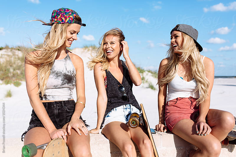 skater girl with friends by Brian Powell for Stocksy United
