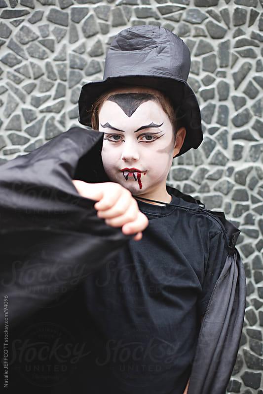 boy dressed as vampire for Halloween by Natalie JEFFCOTT for Stocksy United