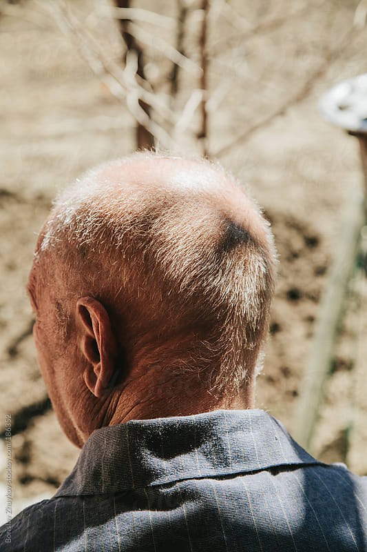 Portrait of an old man from behind by Borislav Zhuykov for Stocksy United