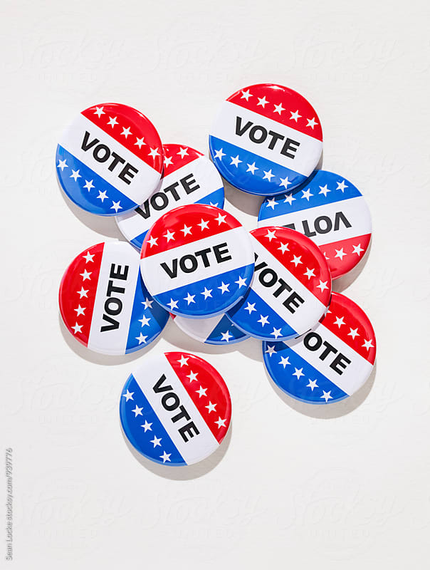 Vote: Pile Of Voting Pins On White Textured Background by Sean Locke for Stocksy United