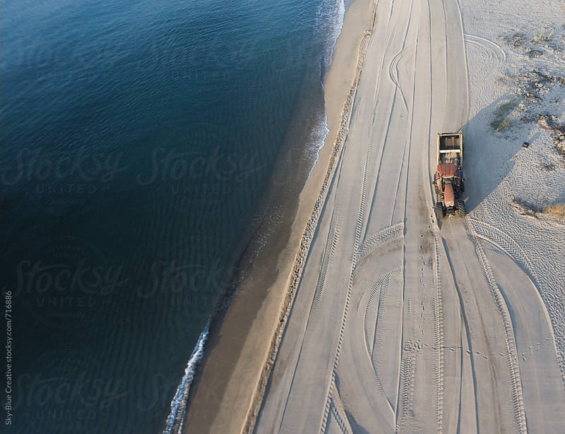 Truck cleaning the beach by Luca Pierro for Stocksy United