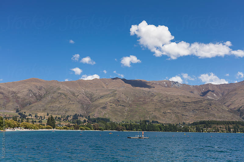 Beautiful spring day on Lake Wanaka, New Zealand. by Robert Zaleski for Stocksy United