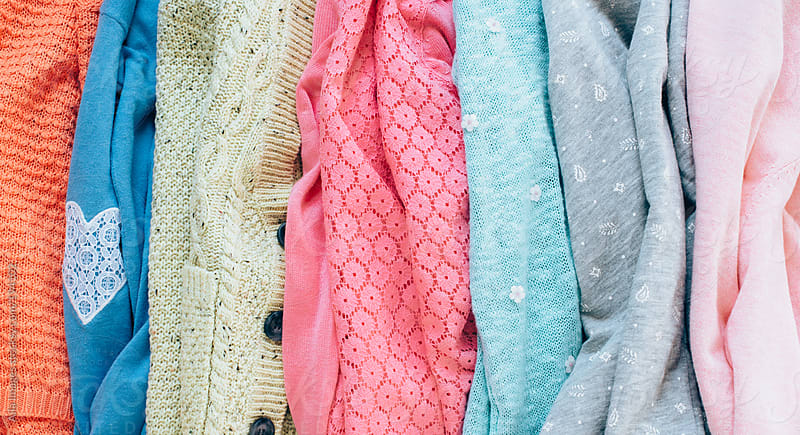Fashionable stack of Women's Sweaters in Spring Colors by Aila Images for Stocksy United