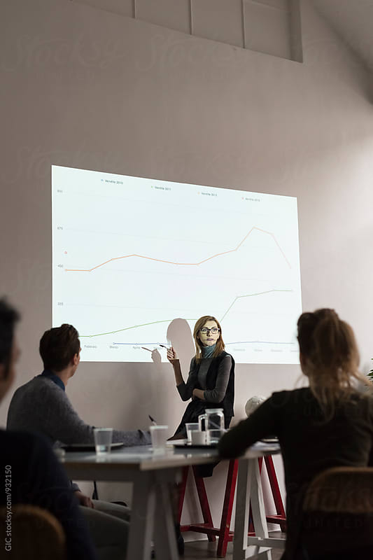 Presentation during a business meeting in office by Simone Becchetti for Stocksy United
