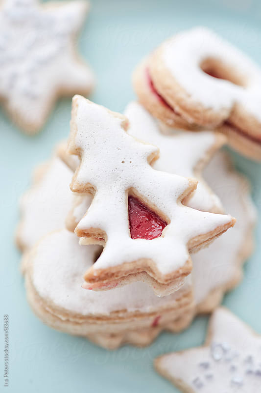 Food: Stacked linzer christmas cookies with icing by Ina Peters for Stocksy United