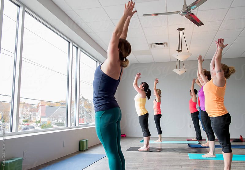 Yoga class in a modern studio by Cara Dolan for Stocksy United