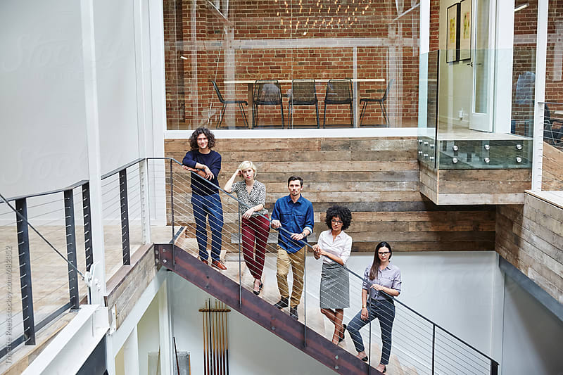 Group portrait of millennials in high tech office  by Trinette Reed for Stocksy United