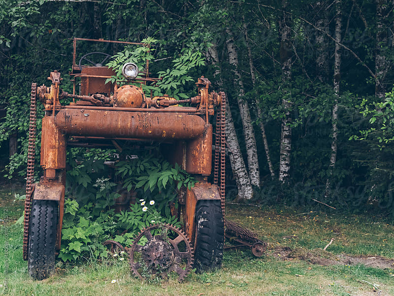 abandoned tractor at Forks, Seattle, WA, USA by unite  images for Stocksy United