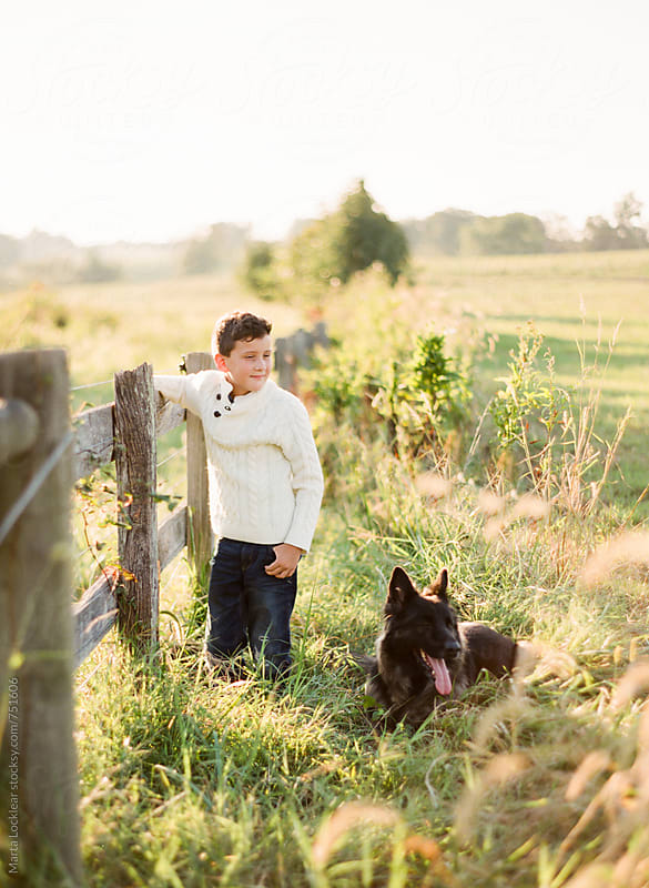 Boy & His Dog by Marta Locklear for Stocksy United