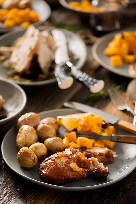 Rustic Roasted Chicken Dinner on Plate by Jeff Wasserman for Stocksy United