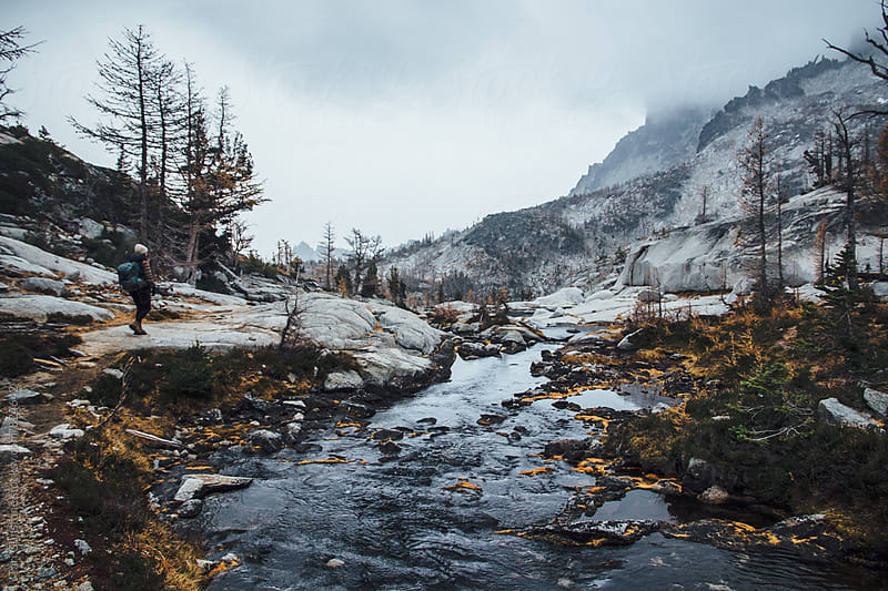 Hiker explores beautiful, wild landscape by Tari Gunstone for Stocksy United