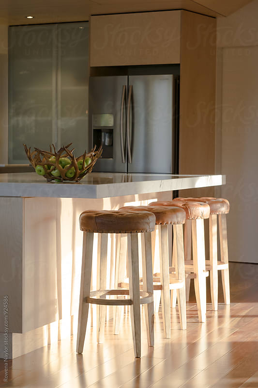 Kitchen bar stools by Rowena Naylor for Stocksy United