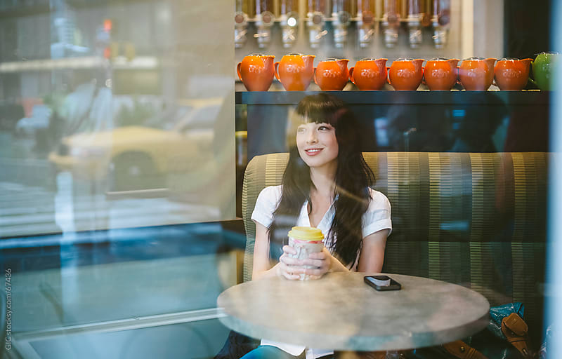 Woman relaxing in cafe, NYC by GIC for Stocksy United