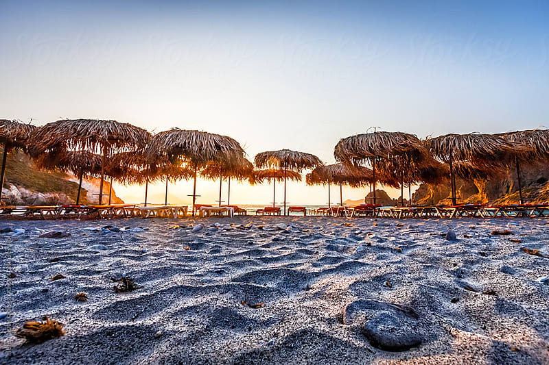 Umbrellas on the Beach at Sunset by Helen Sotiriadis for Stocksy United