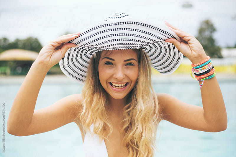 Young woman in a bikini smiling by Jovana Rikalo for Stocksy United