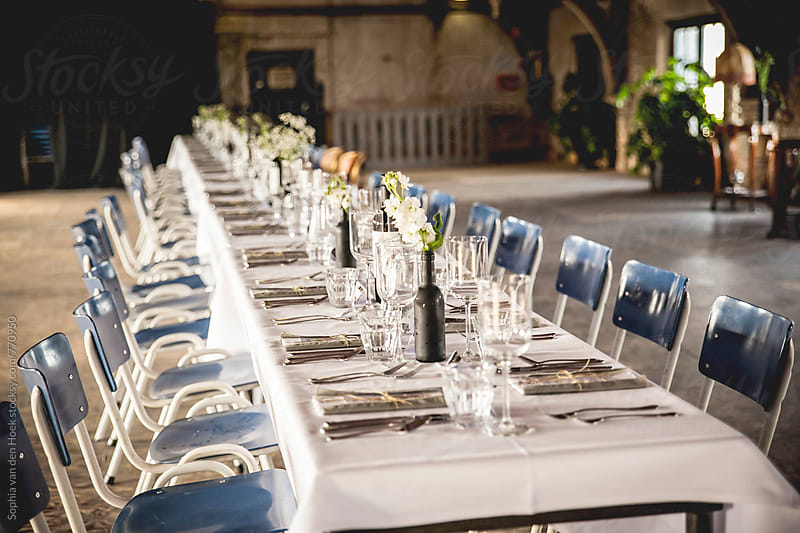 Long table in church by Sophia van den Hoek for Stocksy United