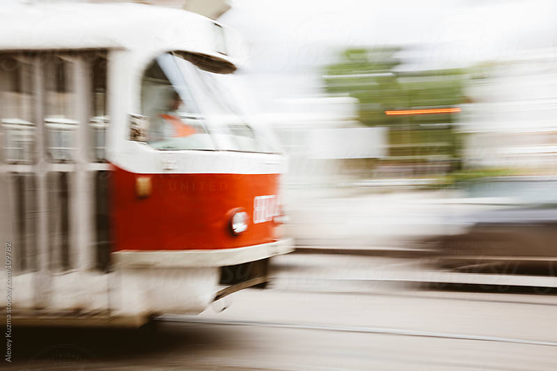 Motion blurred red tram  by Alexey Kuzma for Stocksy United