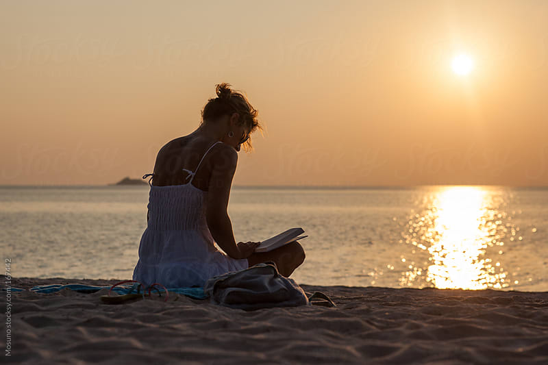 Silhouette of a Woman Reading a Book by Mosuno for Stocksy United